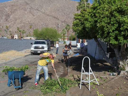 Bryan Johnson helps cleanup the Well in the Desert's new location at 441 S. Calle Encilia, June 27, 2017.
