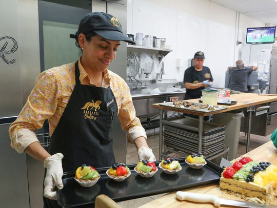 Elizabeth Cervantes prepares some sweets at Carousel