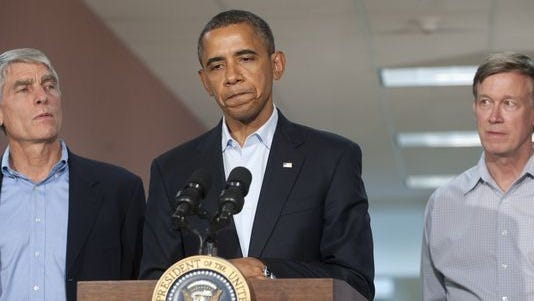 "US President Barack Obama speaks alongside Colorado Senator Mark Udall and Colorado Governor John Hickenlooper (R) at the University of Colorado Hospital in Aurora, Colorado, July 22, 2012, following a visit with victims and family members of last week's shootings during a midnight showing of the new Batman movie, ""The Dark Knight Rises,"" at a nearby movie theater that left 12 killed and 58 injured."