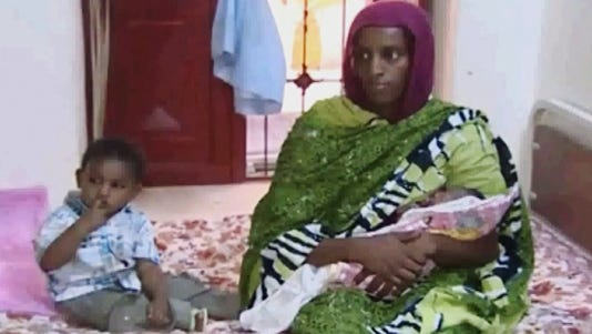 A photo taken from video shows Meriam Ibrahim with her 18-month-old son and a newborn.