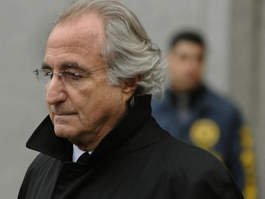 Bernard L. Madoff leaves US Federal Court January 14, 2009 after a hearing regarding his bail in New York.