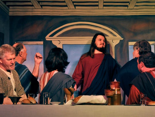 Jared Kingston (center) portrays Jesus in a dress rehearsal for the Living Last Supper at St. James United Methodist Church on Wednesday . Kingston, 21, grew his hair for three years to play the part.