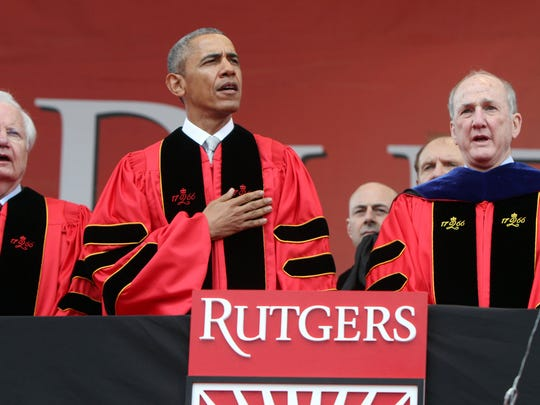 President Barack Obama stands with fellow honoree Bill Moyers (left) and Rutgers President Robert Barchi  during the opening of Rutgers University's 250th Anniversary Commencement at High Point Solutions Stadium in Piscataway, NJ, Sunday, May 15, 2016.  (Photo by Thomas P. Costello / Asbury Park Press)