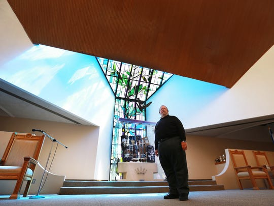 Rabbi Stephen Leon stands in the sanctuary of the Congregation