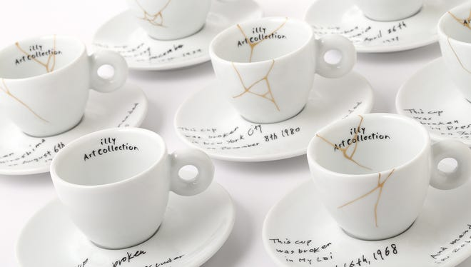 A collection of espresso cups and saucers called, Yoko Ono: Mended Cups - illy Art Collection, featuring the dates and places of six tragic events written in Ono's handwriting. The collection is inspired by Kintsugi, the Japanese technique of repairing cracked pottery with brushstrokes of gold. The line for illy Art Collection is being released alongside Ono's upcoming show at the Museum of Modern Art.