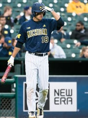 Jake Bivens (18) of the Wolverines prepares to bat