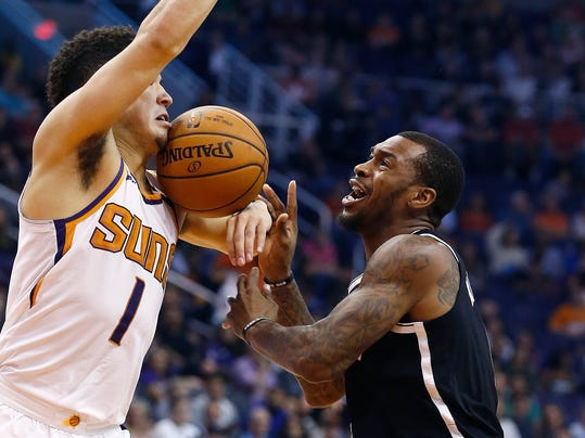 Brooklyn Nets guard Sean Kilpatrick (6) loses the ball to Phoenix Suns guard Devin Booker (1) during the first half of an NBA basketball game Monday, Nov. 6, 2017, in Phoenix. (AP Photo/Ross D. Franklin)