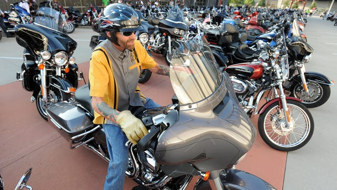 Randy Evchuk heads out at the 2015 Milwaukee Rally at the Harley-Davidson Museum in Milwaukee.