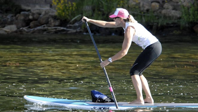 Some visitors paddleboard at Big Bear Lake, where a harmful algal bloom was recently reported.