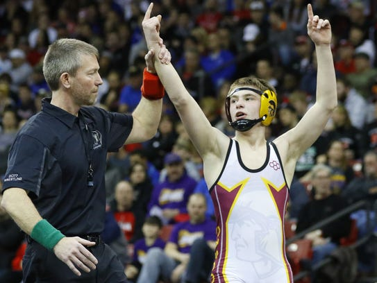 Luxemburg-Casco's Bryce Bosman has his hand raised after winning the WIAA Division 2 113-pound championship match last year at the Kohl Center.