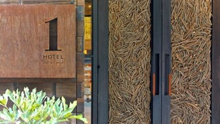 Guests enter the new ! Hotel Central Park through two large steel doors made out of 16,000 twigs.