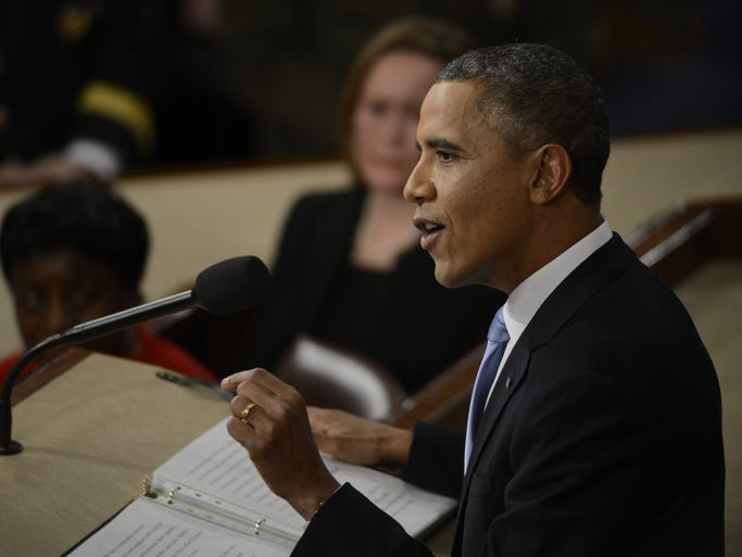 """President Obama delivers his State of the Union Address.""""America does not stand still, and neither will I,"""" he said."""