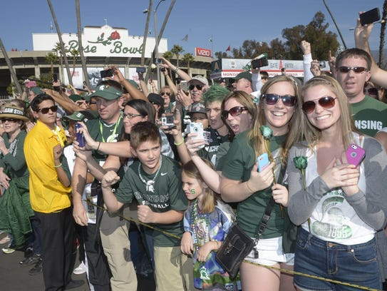 Michigan State Spartans fans tailgate before the 100th