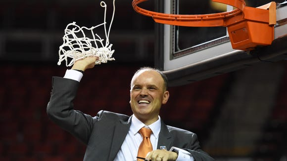 Mar 6, 2016; Seattle , WA, USA; Oregon State head coach Scott Rueck celebrates after cutting down the net following the Beavers victory over UCLA in the women's Pac-12 tournament championship game at Key Arena in Seattle.