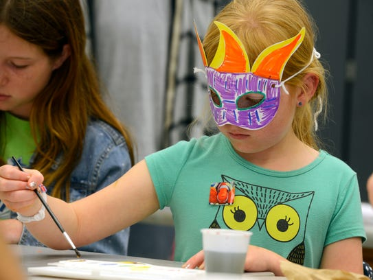 Breanna Hensley,8, creates her own art Sunday during