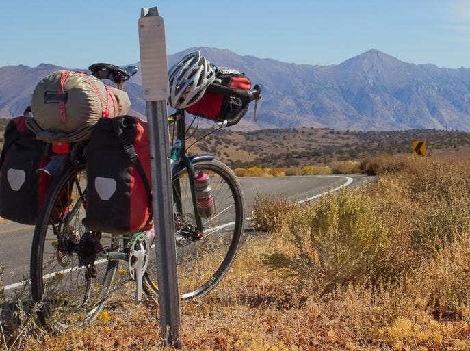 On the bicycling portion of the 'Strange Loop' journey Adam Bradley will ride more than 7,000 miles on a loaded up Kona Sutra touring bicycle.