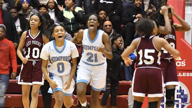 Detroit Mumford's Tiara Earnest and Zamaria Polk celebrate as the clock hits zero with a 60-58 victory over Detroit Renaissance on Friday at Calihan Hall.