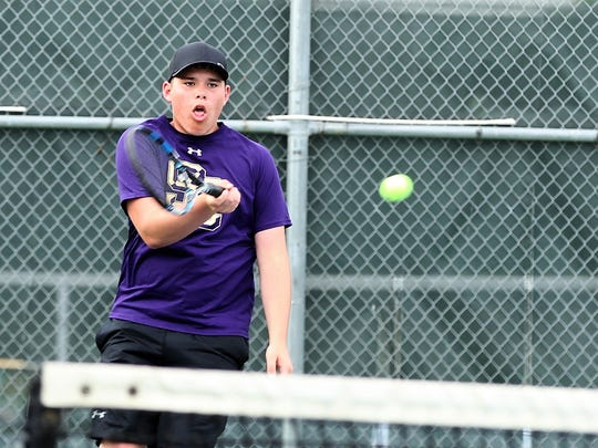 Sterling City's Dain Copeland returns a serve during mixed doubles action at the  Region II-1A Tennis Tournament Thursday at Bentwood Country Club.