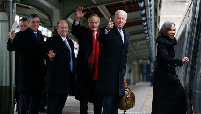 Delawareans (from left) Gov. John Carney, Senator Chris Coons, Senator Tom Carper, Vice President Joe Biden and Congresswoman Lisa Blunt Rochester board an Amtrak Acela train at Union Station bound for Wilmington after attending inauguration events in Washington Friday, Jan. 20, 2017.