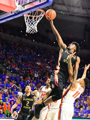 Florida State junior guard Terance Mann (14) goes for the alley-oop during the second half against Florida at the O'Connell Center.