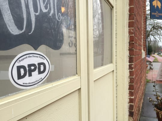 A sticker in the window of a Dover store shows support for the city's police department. The stickers appeared in many storefronts after Cpl. Thomas Webster IV was indicted by a grand jury on an assault charge stemming from a violent arrest; he was acquitted in a jury trial, and resigned on Feb. 23.