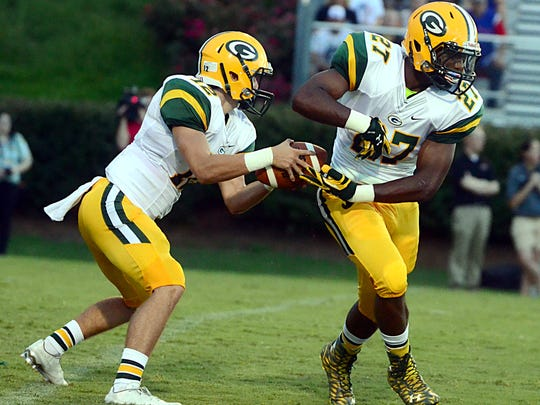 Gallatin seniors Wyatt Hayes and Jordan Mason (27) hope to help the Green Wave bounce back from their season-opening loss at Mt. Juliet