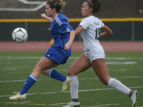 Serrano's Rachel Gnuse, left, and Royal's Kailyn Fuller compete for the ball during their second-round match on Tuesday.