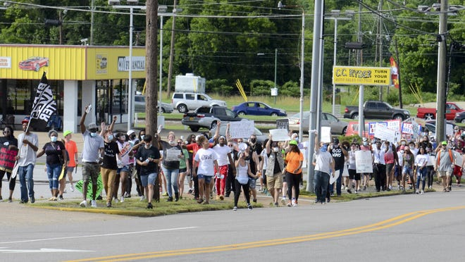Protesters march and chant outside the Etowah County Detention Center during a Black Lives Matter march in Gadsden on Sunday, June 7.
