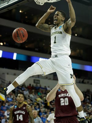 Michigan guard Charles Matthews (1) dunks during the first half of an NCAA men's college basketball tournament first-round game against Montana, Thursday, March 15, 2018, in Wichita, Kan. (AP Photo/Orlin Wagner)