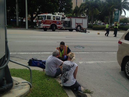 A worker talks to victims of a car crash on U.S. 41 on Wednesday.