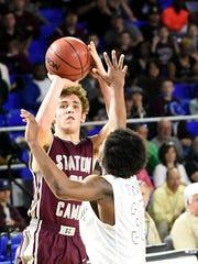 Station Camp High junior Thomas Zazzaro elevates to shoot a 3-pointer over Cordova senior Curtis Reeder during fourth-quarter action. Zazzaro scored six points.