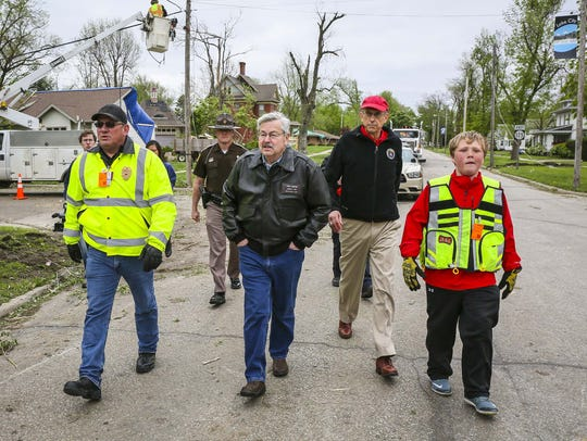Iowa Gov. Terry Branstad, center, tours the damage