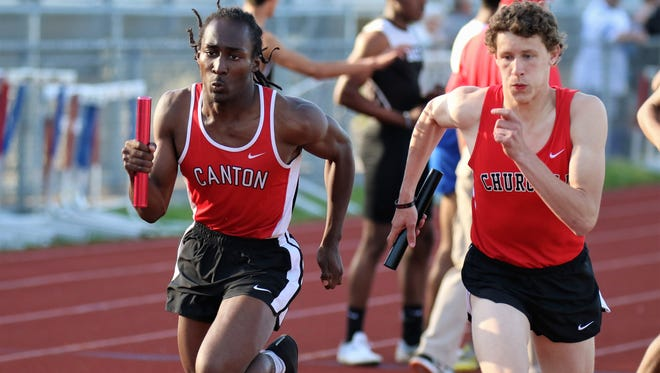 Canton's Jemal Vaunado and Livonia Churchill's Frank LaFave race to the finish in the final leg of the 1,600-meter relay.