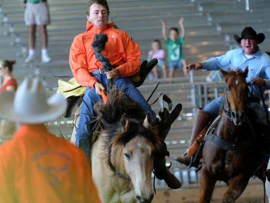 Marshall Davis, of Syfrett Ranch in Okeechobee, hangs on for a full 8-second ride in the bronco riding event at a previous Adams Ranch rodeo. This year's event is Saturday at the St. Lucie County Fairgrounds.