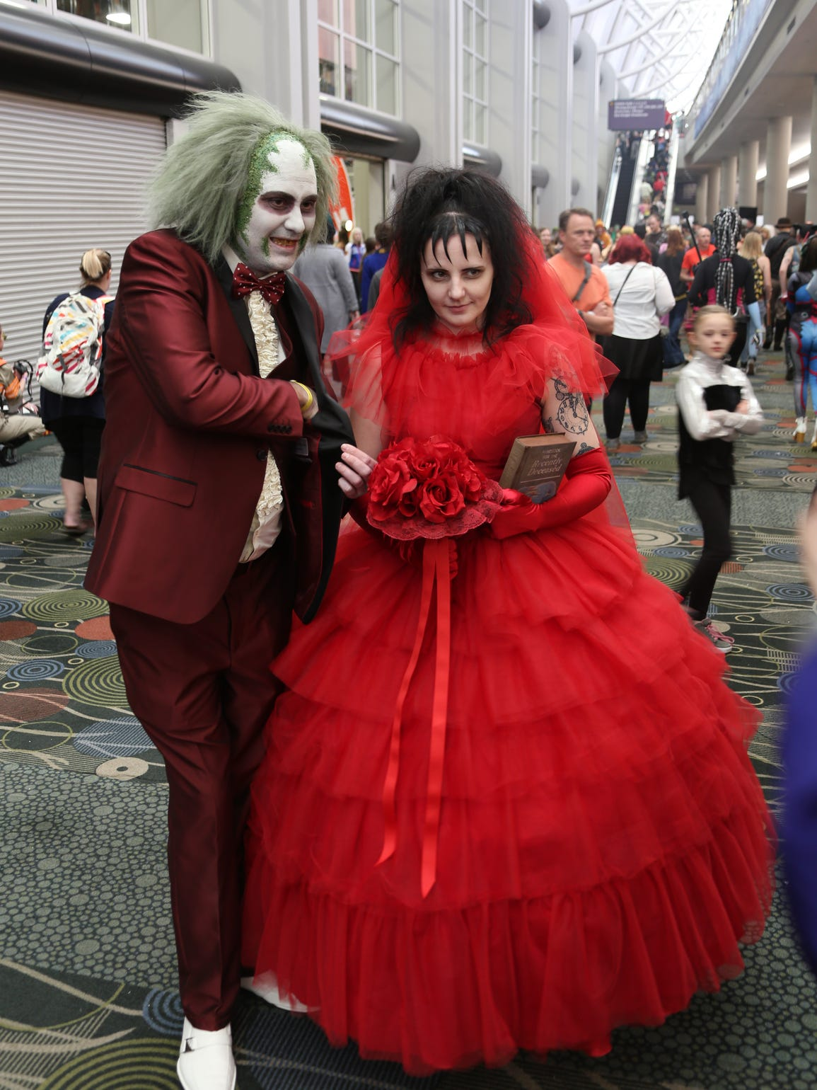 "Cosplayers dressed as characters from ""Beetlejuice"""