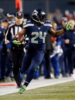 January 10, 2015; Seattle, WA, USA; Seattle Seahawks running back Marshawn Lynch (24) runs the ball against the Carolina Panthers during the second half in the 2014 NFC Divisional playoff football game at CenturyLink Field.