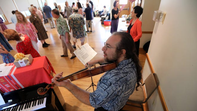 Marnen Laibow-Koser, of Watertown, MA, plays the violin during the bi-monthly North Jersey English Country Dance Party at The Unitarian Society in Ridgewood.  Sunday August 27, 2017