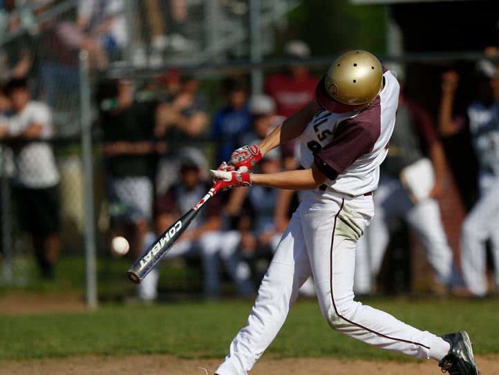 Arlington's Jack Melanophy hits during Monday's playoff