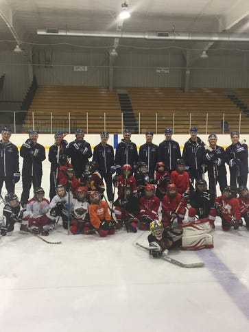 Wisconsin Rapids Riverkings hockey players ran the