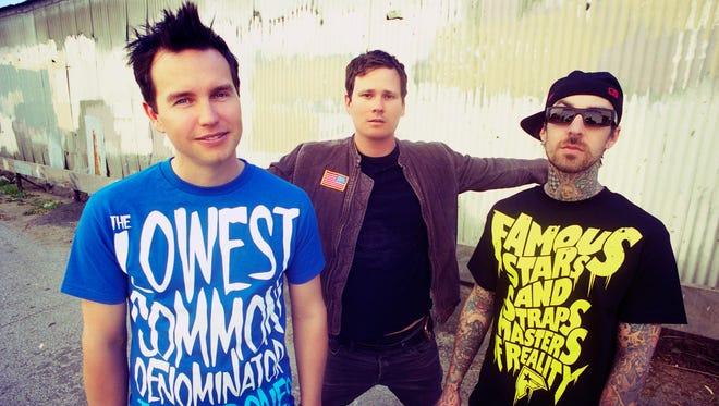 Blink 182 members Mark Hoppus, left, Tom Delonge and Travis Barker.