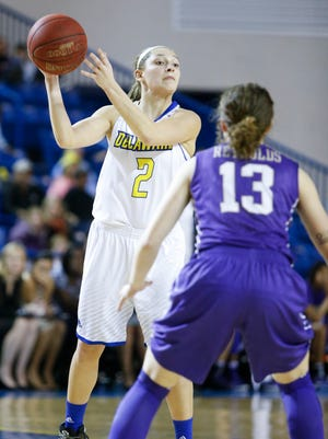 Delaware's Abby Gonzales (2) passes in the second half of Delaware's loss to JMU at the Carpenter Center.