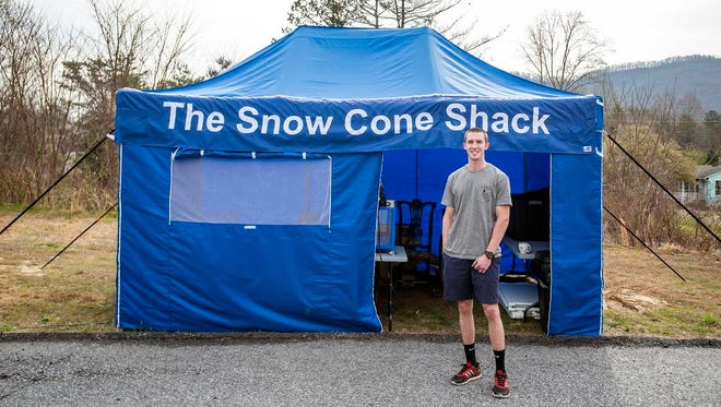 Ian Huffman, 18, stands outside The Snow Cone Shack, his new business, opening Easter Sunday in Biltmore Forest. Huffman said he wanted to open an accessible snow cone shop to serve a community with few options for snow cones in the summer.