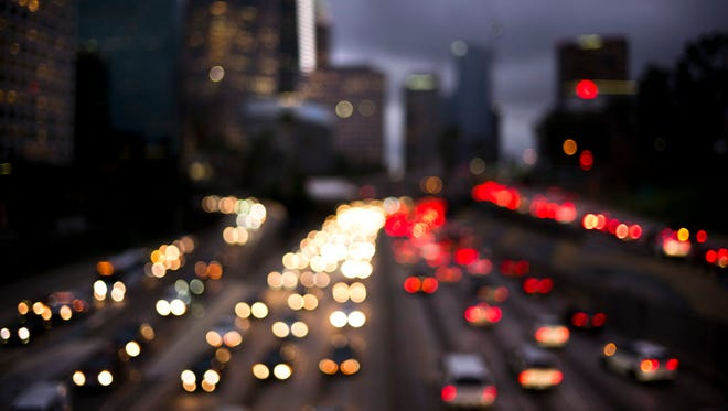 In this defocused image, traffic moves along the 110 Freeway on Dec. 20, 2017, in downtown Los Angeles.