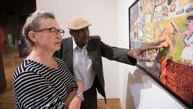 Hassan Nor, 81, is a self-taught artist who produces drawings about life in Somalia before the Civil War.