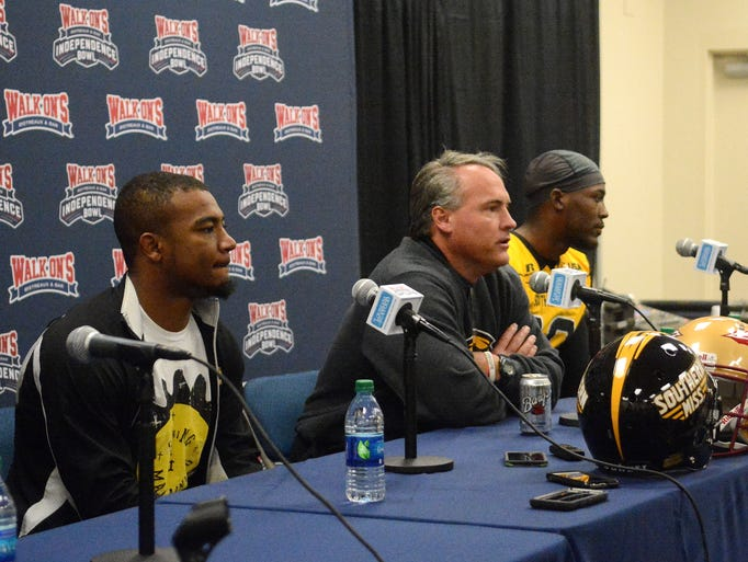 Southern Miss coach and players at post-game press