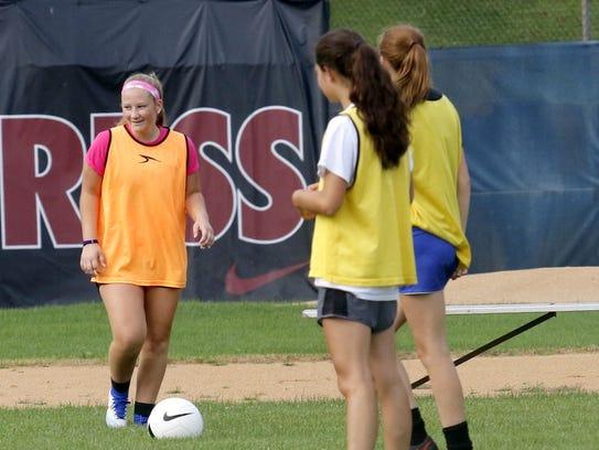 The Elmira High School girls soccer team practices