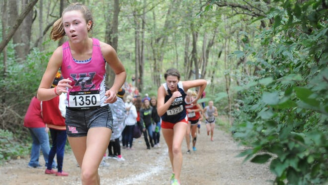 West Lafayette's Emma Tate runs uphill en route to a 14th-place finish during Saturday's IHSAA regional.