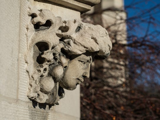 A bust is seen hanging on the outside of Reid Memorial