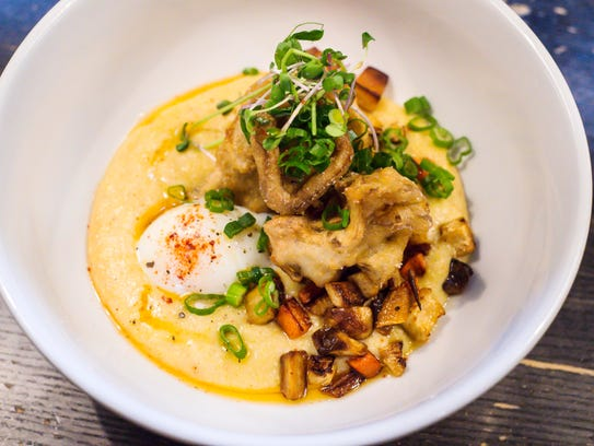 Maple chili polenta with crispy mushrooms, glazed root vegetables and a poached egg prepared by Jaclyn Major, the new chef at Butch and Babe's in Burlington on Thursday, February 1, 2018.