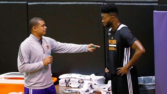 Suns coach Earl Watson talks to former Cal forward Jaylen Brown during the Phoenix Suns Draft Workout in Phoenix, Ariz., on Monday, June 6, 2016.